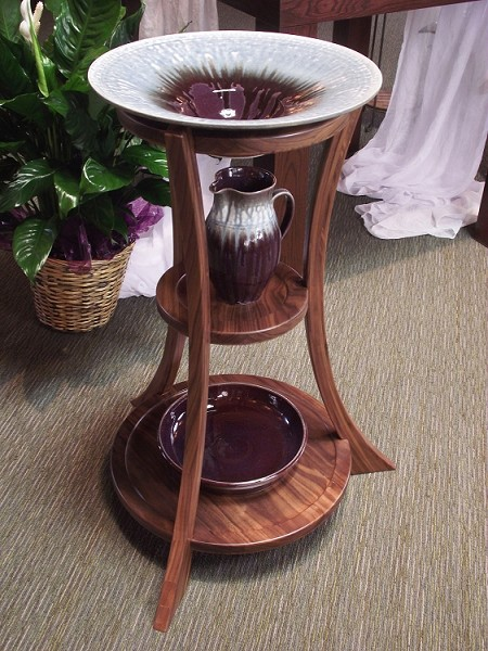 Eternal Waters font stand in Walnut with Eggplant/Blue glazed pottery